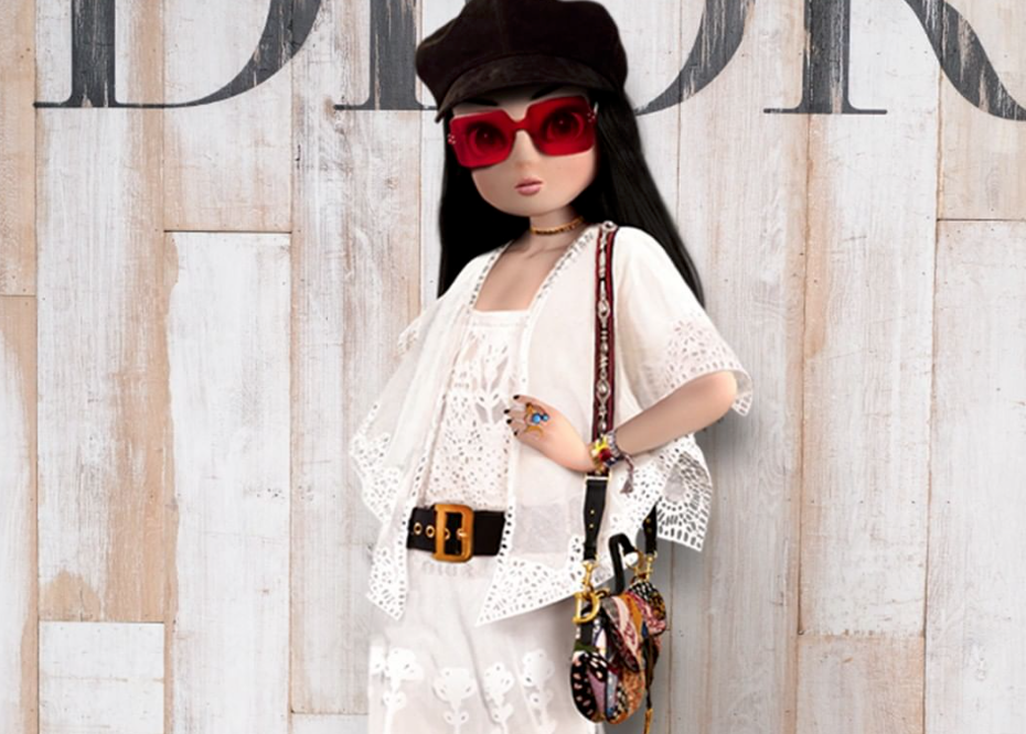 Noonoouri carrying the Saddle bag at the Dior Cruise Show